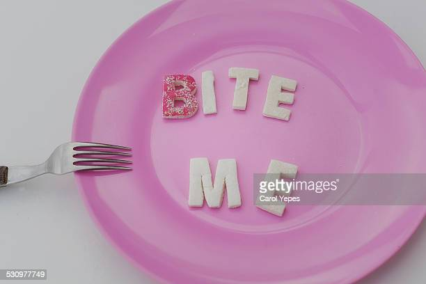 bite letters in a plate - typographies stock photos and pictures