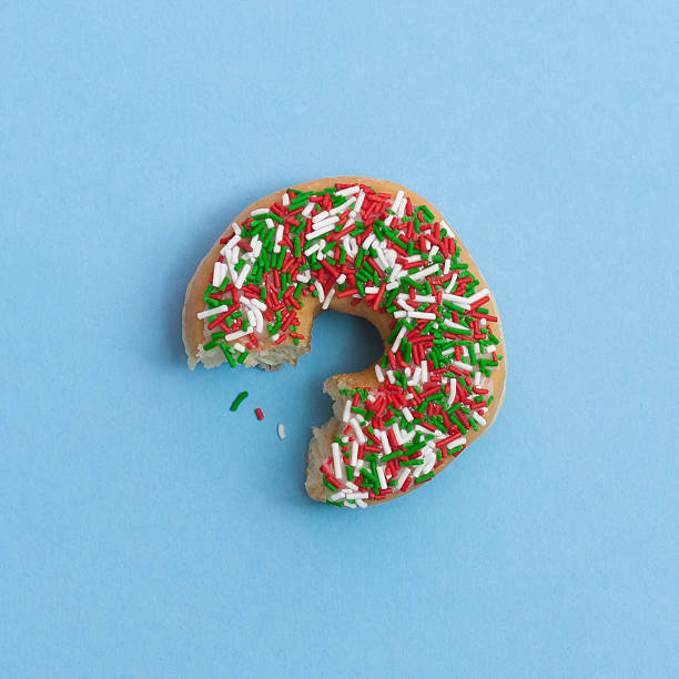 Bite Out Of A Sprinkle Donut, On A Blue Background Wall Art