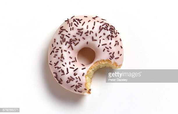 Bite out of white doughnut