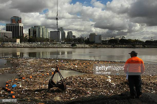 Bitelio Ramirez looks out over tons of trash and debris has piled up near the mouth of the Los Angeles River after two days of heavy rain fell in...