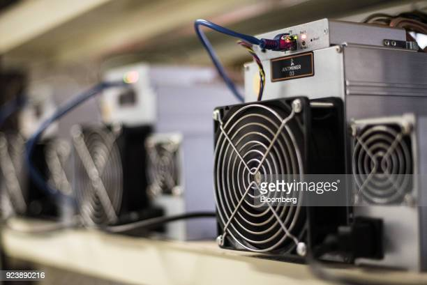 Bitmain Technologies Ltd Antminer mining rigs sit inside the cryptocurrency mining farm and school at the Ministry of Youth and Sports facility in...