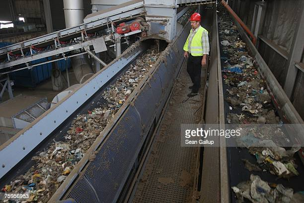 Bits of garbage flow through conveyors for sorting at a garbage processing center August 3 2007 in Nuemuenster Germany The center known as a...