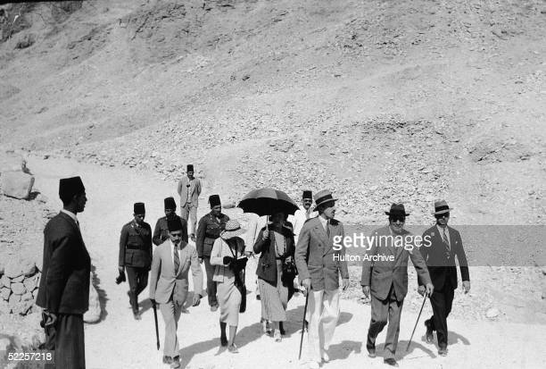 Bitsih archaeologist Howard Carter shows former Spanish monarch King Alfonso XIII through the Valley of the Kings to view the tomb of Pharaoh...