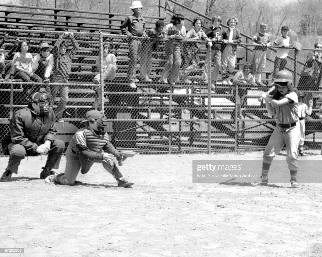Bitsy Osder, 9, first girl to play Little League baseball in New Jersey, looks over a pitch in Englewood, N.J. 'That ain't my style,' said Bitsy. 'Strike one,' the umpire Jack Spillert said. Bitsy struck out her first time up. And her Orioles lost to Red Sox.
