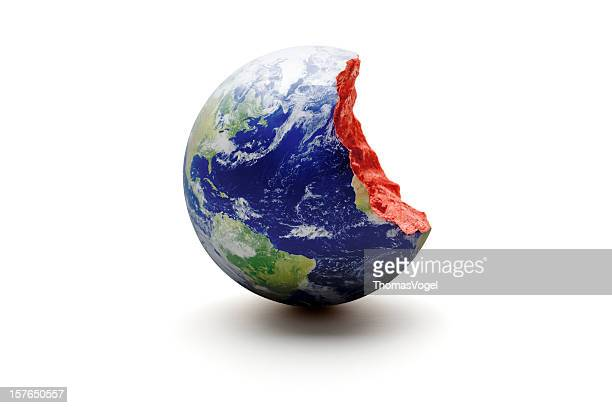 bitten earth world globe. exploitation environment concept - core stock pictures, royalty-free photos & images