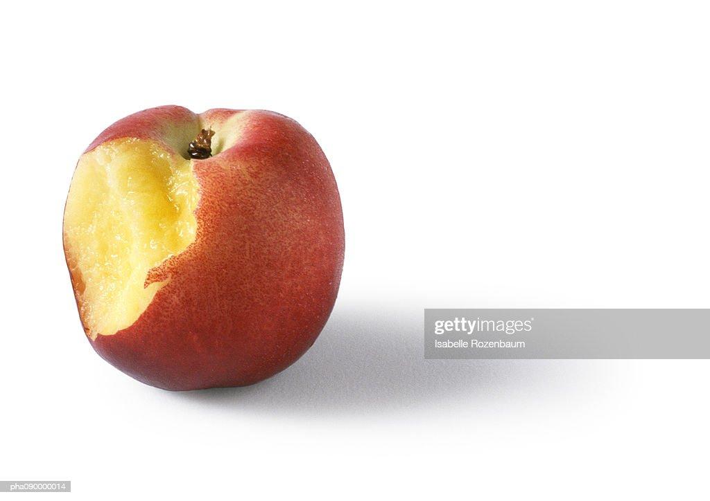 Bitten peach, white background : ストックフォト