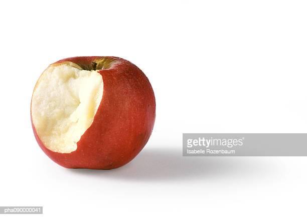Bitten red apple, white background