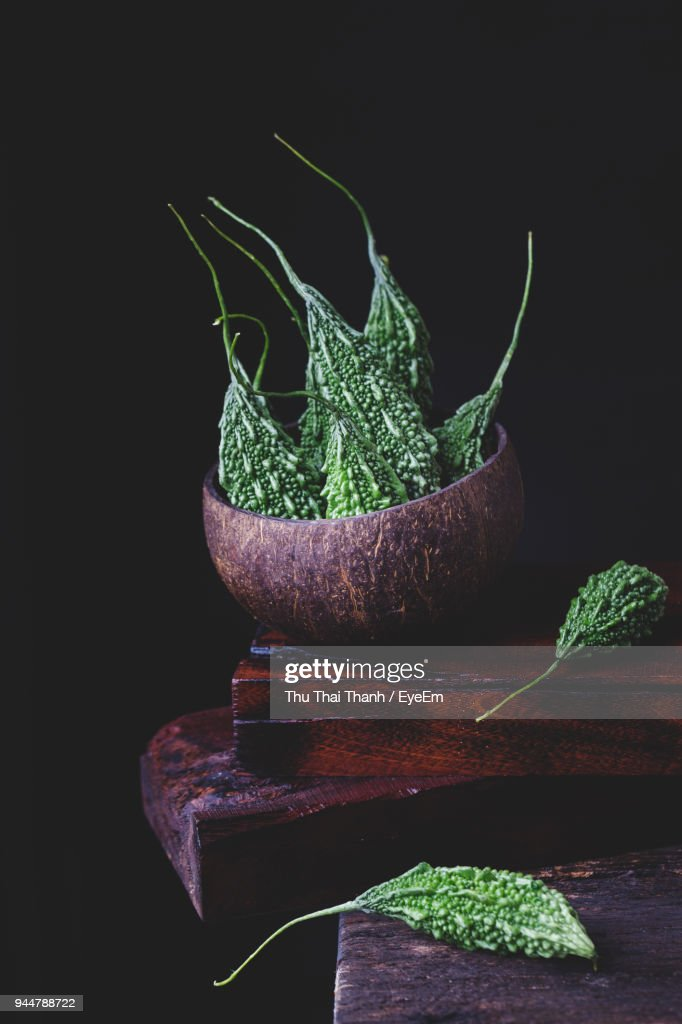 Bitter Gourds In Basket On Table : Stock Photo