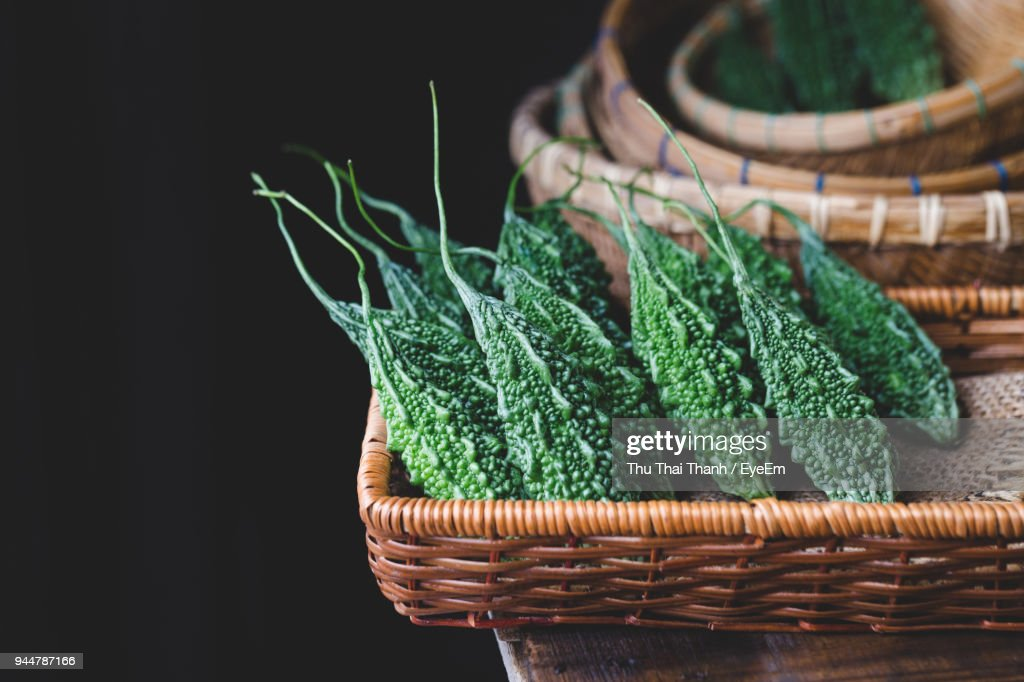 Bitter Gourds With Baskets On Table : Stock Photo