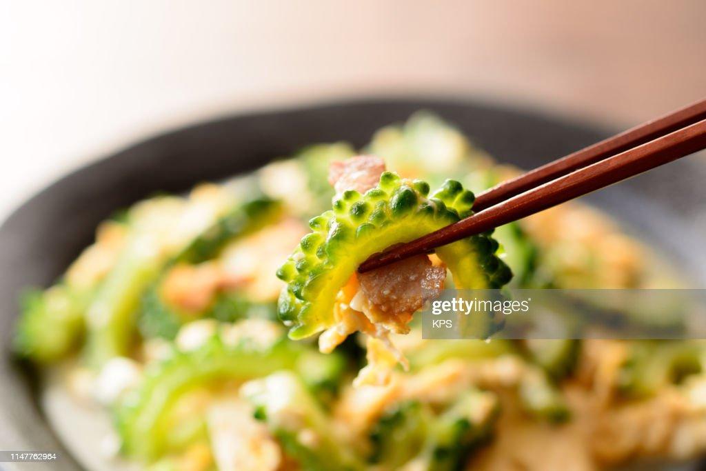 bitter melon stir-fried with pork, tofu and egg. : Stock Photo