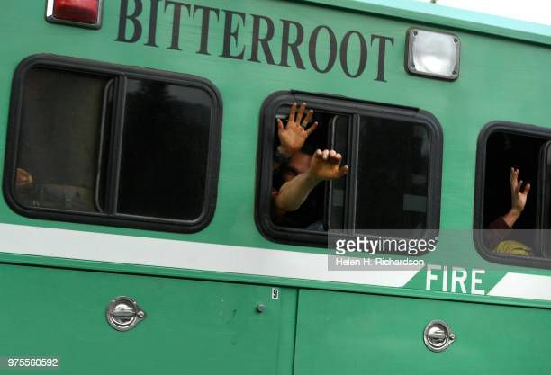 Bitterroot Hotshots wave to neighbors lining the streets to show their support for the work firefighters are doing on the 416 Fire on June 14 2018 in...