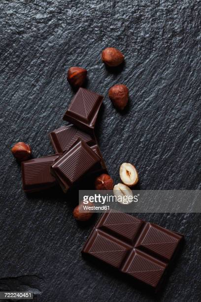 bittersweet chocolate and hazelnuts on slate - hazelnuts stock pictures, royalty-free photos & images