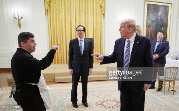 Bitty Beau's Coffee employee Michael Heup offers an invitation to US President Donald Trump after the president spoke in the East Room of the White...