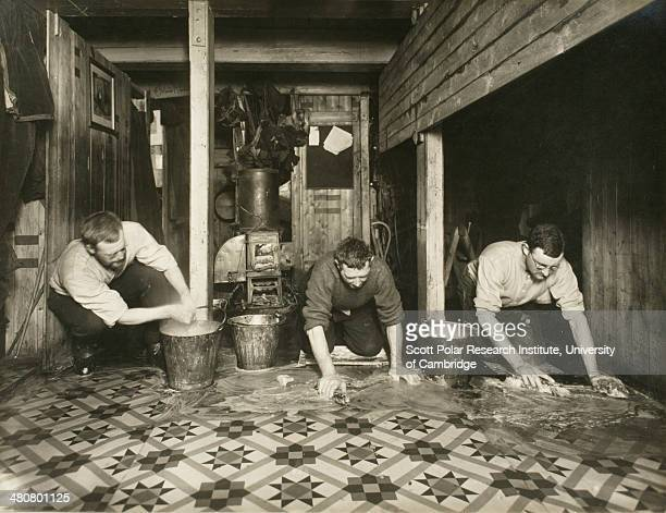 Biweekly ablutions of 'The Ritz' on board the 'Endurance' during the Imperial TransAntarctic Expedition 191417 led by Ernest Shackleton From left to...