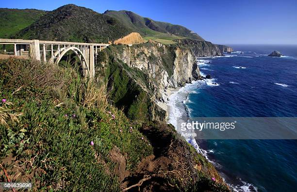 Bixbie Creek Bridge along the State Route 1 / Pacific Coast Highway 1 and view over the Pacific Ocean in California US