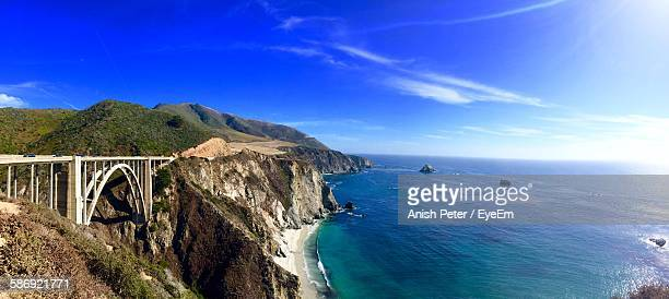 Bixby Bridge And Mountains By Sea Against Sky