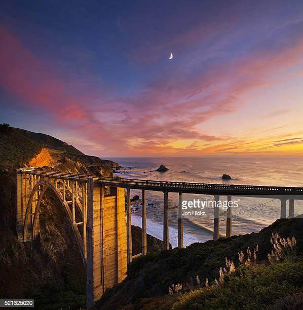 bixby bridge at sunset. - bixby bridge stock photos and pictures