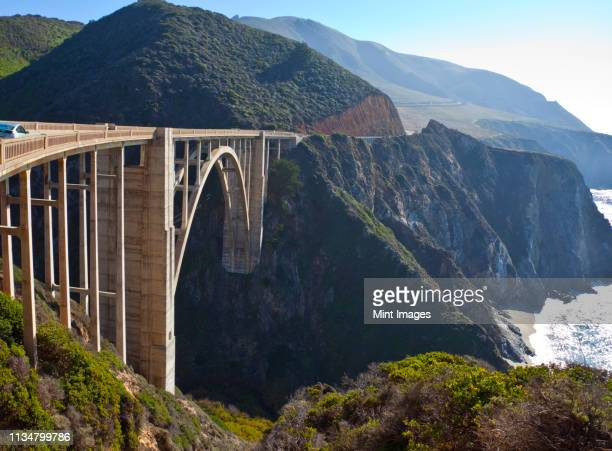 bixby bridge crossing a chasm - central california stock pictures, royalty-free photos & images