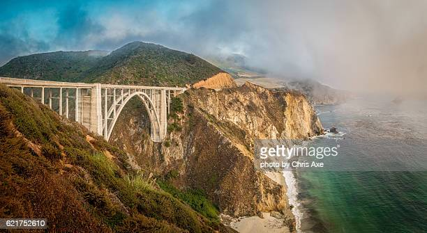 bixby bridge with fog - big sur, ca - big sur stock photos and pictures