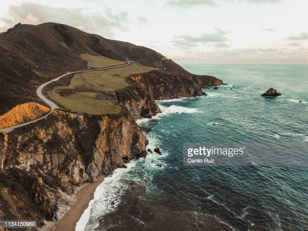 bixby creek bridge big sur aerial view highway one california coast beach sunset - big sur stock pictures, royalty-free photos & images