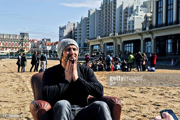 Bixente Lizarazu former international football player poses for photographers prior to take part in a beach cleanup event as the godfather of the...