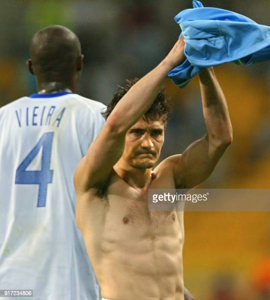 Bixente Lizarazu of France acknowledges the fans as Patrick Vieira walks off, 06 June 2002 at the Busan Asiad Main Stadium in Busan, following the...