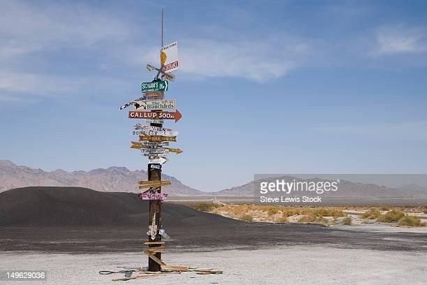 Bizarr sign post in California desert.