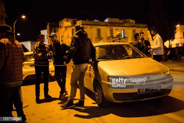 Bizerte, Tunisia, 27 February 2016. Rappers and dancers from the same event hang out at night.
