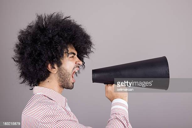 Bizzare Man With Curly Hair Shouting On Old Fashioned Megaphone