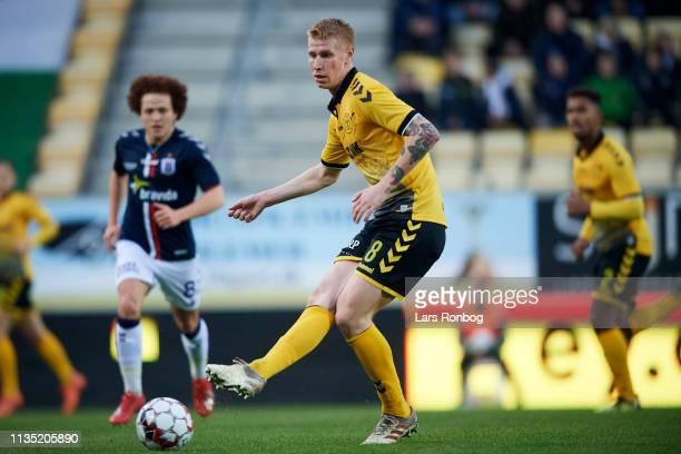 Bjarke Jacobsen of AC Horsens passes the ball during the Danish Superliga match between AC Horsens and AGF Aarhus at CASA Arena Horsens on April 5...