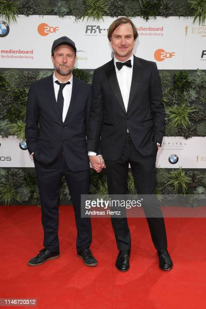 Bjarne Mädel and Lars Eidinger attend the Lola - German Film Award red carpet at Palais am Funkturm on May 03, 2019 in Berlin, Germany.