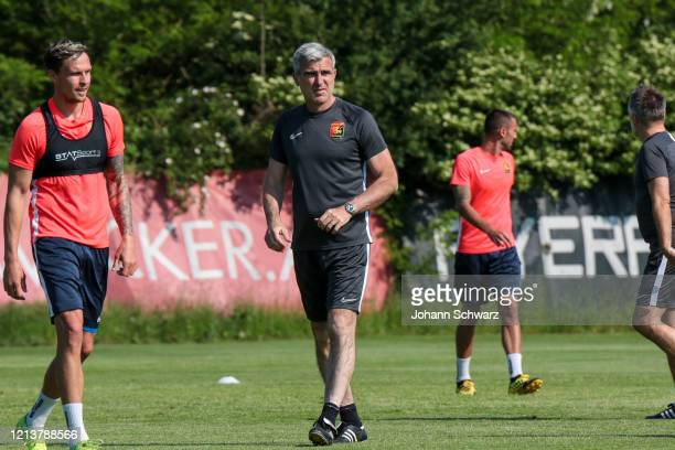Bjarne Thoelke and Head coach Zvonimir Soldo of Admira during the first team training session after the nationwide lockdown due to the ongoing...