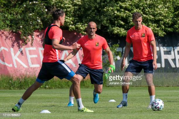 Bjarne Thoelke Erwin Hoffer and Roman Kerschbaum of Admira during the first team training session after the nationwide lockdown due to the ongoing...