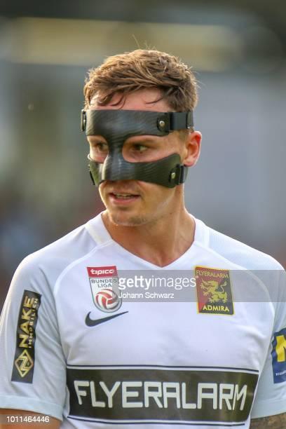 Bjarne Thoelke of Admira with mask during the tipico Bundesliga match between TSV Hartberg v FC Admira at Profertil Arena Hartberg on August 5, 2018...