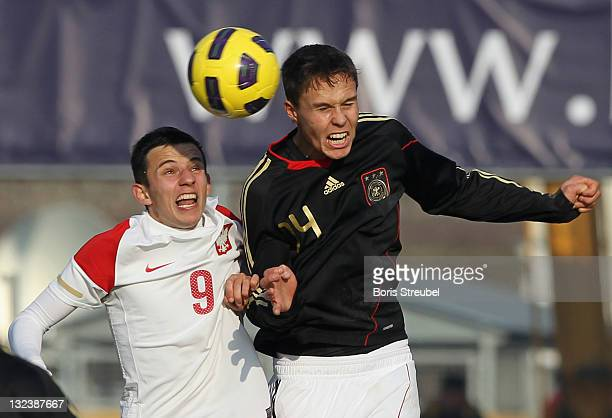 Bjarne Thoelke of Germany jumps for a header with Rafal Wolski of Poland during the U20 International Friendly match between Poland and Germany at...