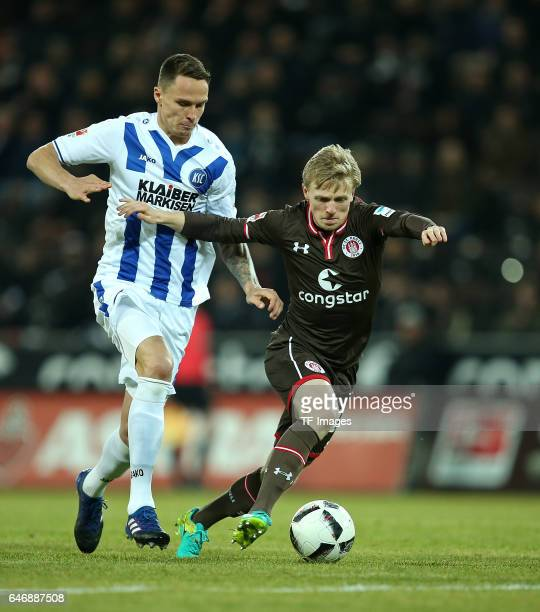 Bjarne Thoelke of Karlsruhe and Mats Moeller Daehli of Pauli battle for the ball during the Second Bundesliga match between FC St Pauli and...