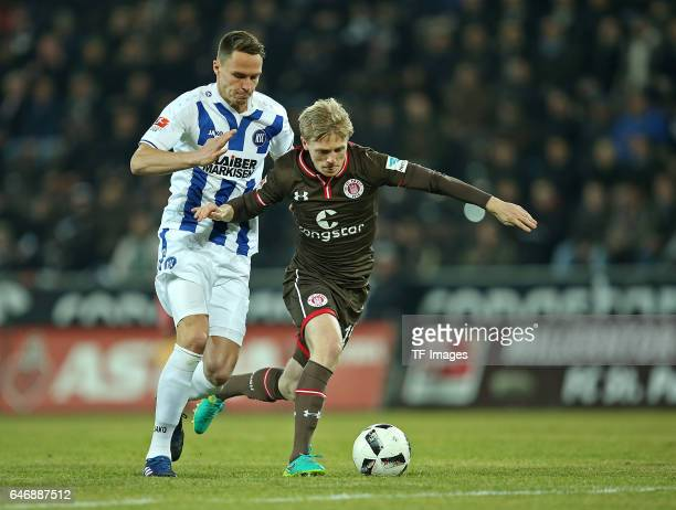 Bjarne Thoelke of Karlsruhe and Mats Moeller Daehli of Pauli battle for the ball during the Second Bundesliga match between FC St. Pauli and...