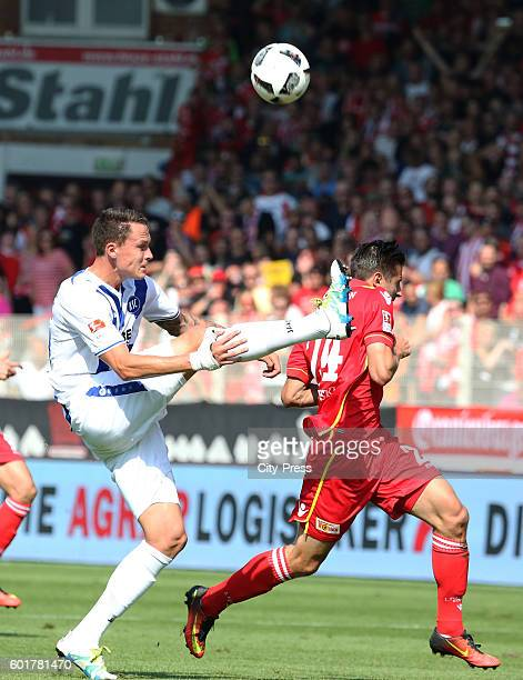 Bjarne Thoelke of Karlsruher SC and Steven Skrzybski of 1 FC Union Berlin during the game between dem 1 FC Union Berlin and dem Karlsruher SC on...