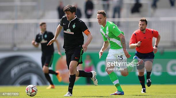 Bjarne Thoelke of Wolfsburg II and Florian Bruns of Bremen II compete for the ball during the Regionalliga Nord match between Werder Bremen II and...