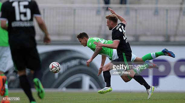 Bjarne Thoelke of Wolfsburg II and Marcel Hilssner of Bremen II compete for the ball uring the Regionalliga Nord match between Werder Bremen II and...