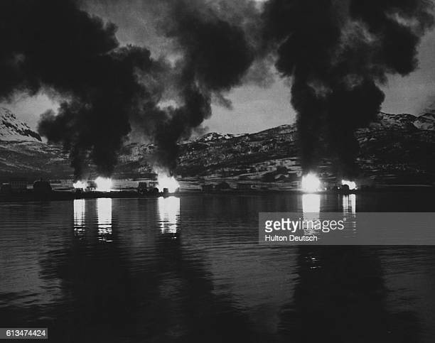 Bjervik burns as the Allied forces drive to capture Narvik farther up from Herjanks Fjord on Rombaks Fjord | Location Bjervik Norway