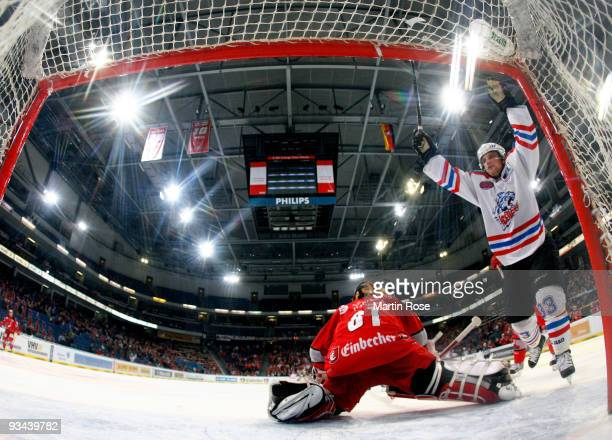 Bjoern Barta of Nuernberg celebrates after scoring his team's 3 rd goal during the DEL match between Hannover Scorpions and Thomas Sabo Ice Tigers at...