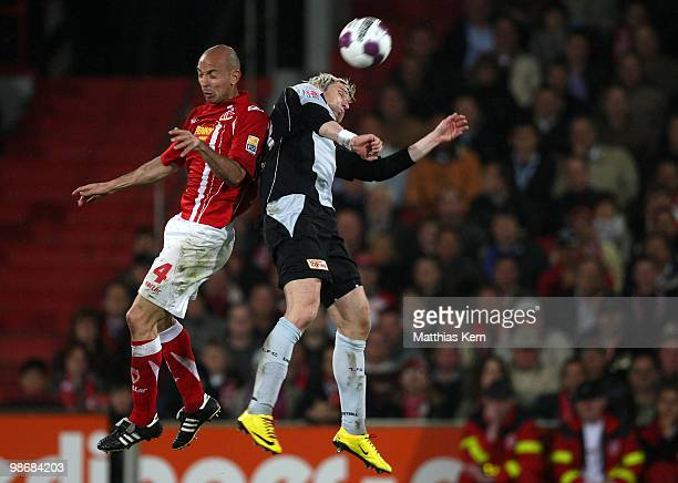 Bjoern Brunnemann of Berlin and Stanislav Angelov of Cottbus jump for a header during the Second Bundesliga match between FC Energie Cottbus and 1.FC...