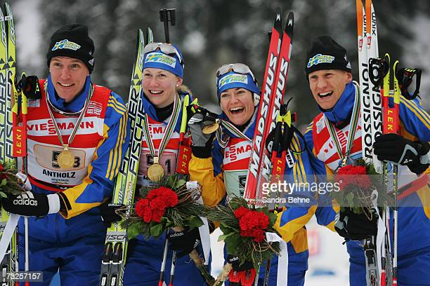 Bjoern Ferry Helena Jonsson Anna Carin Olofsson and Carl Johan Bergman of Sweden celebrate winning the gold medal of the Mixed 2 x 6 km and 2 x 75 km...