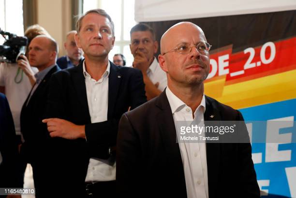 Bjoern Hoecke, and Andreas Kalbitz, lead candidate of the right-wing Alternative for Germany , waits for the initial exit poll results in the...