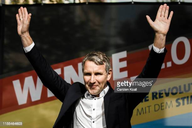 Bjoern Hoecke, leader of the AfD in the state of Thuringia, waves to the supporters during the inaugural AfD election rally in Brandenburg state...