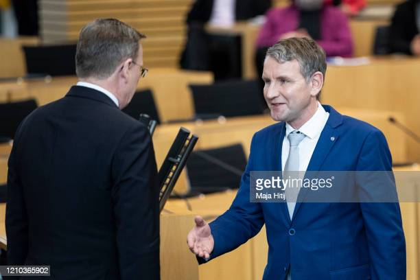 Bjoern Hoecke, leader of the right-wing Alternative for Germany congratulate Bodo Ramelow, leader of the left-wing Die Linke political party in...