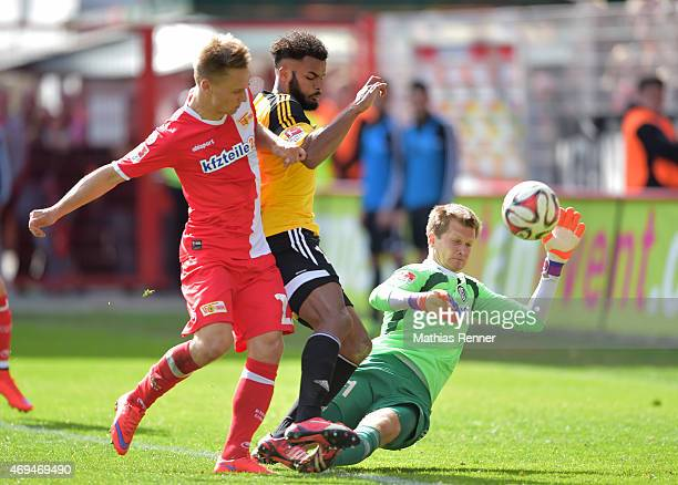 Bjoern Jopek Phil OfosuAyeh and Daniel Bernhardt of VfR Aalen during the game between Union Berlin and VfR Aalen on april 12 2015 in Berlin Germany