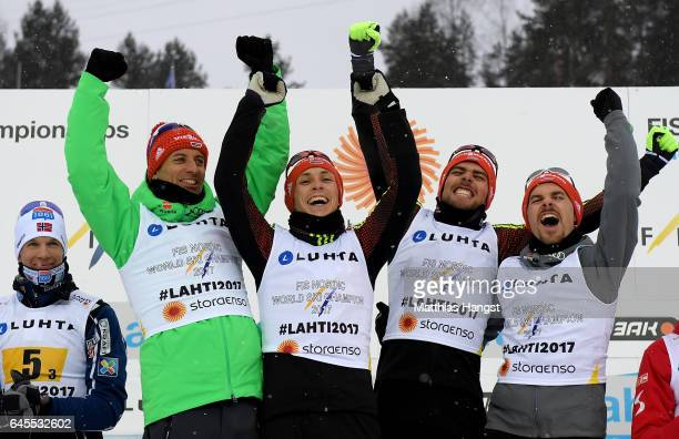Bjoern Kircheisen Eric Frenzel Fabian Riessle and Johannes Rydzek of Germany pose after winning the gold medal in the Men's Nordic Combined Team HS...