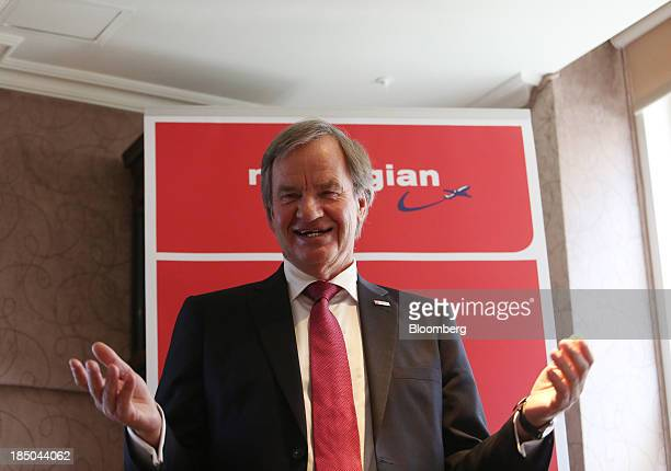 Bjoern Kjos chief executive officer of Norwegian Air Shuttle AS gestures as he speaks during a news conference in London UK on Thursday Oct 17 2013...
